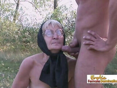 Granny in black fucks a stud on the field | -black-granny-stockings-